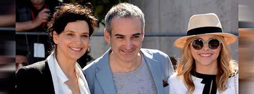 Der französische Regisseur Olivier Assayas mit Juliette Binoche (links) in Cannes, 2014.